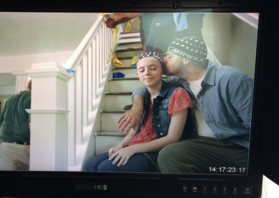 A behind-the-scenes image of CJ Mascarelli (with his daughter Scotlyn) in a commercial for Cable One produced by LaneTerralever.